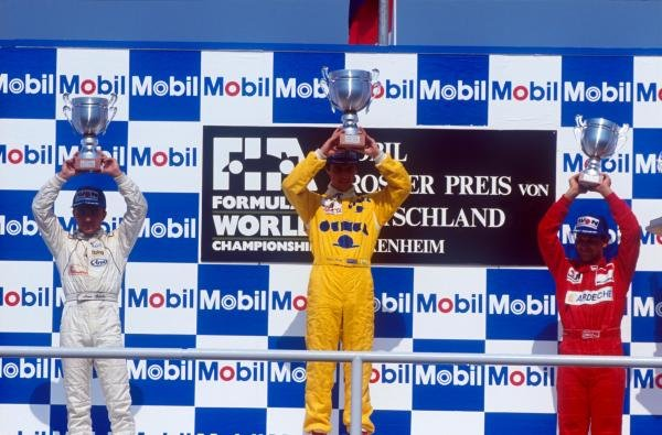 The podium (L to R): Marco Apicella (ITA) second; Eddie Irvine (GBR) winner; Jean-Marc Gounon (FRA) third. International Formula 3000 Championship, Hockenheim, Germany, 29 July 1990.