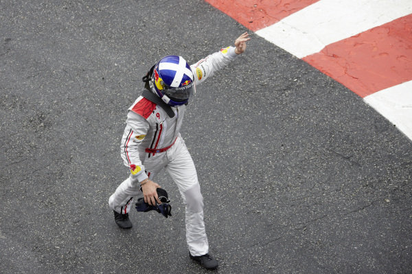 David Coulthard retires from his final F1 race, waving to fans as he returns to the pits.