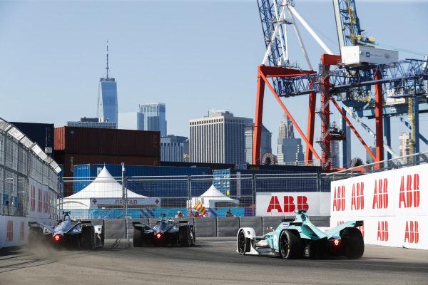 Gary Paffett (GBR), HWA Racelab, VFE-05, leads Edoardo Mortara (CHE) Venturi Formula E, Venturi VFE05 as he locks up in front of Oliver Turvey (GBR), NIO Formula E, NIO Sport 004