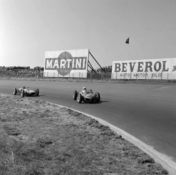 Phil Hill, Ferrari 156, leads Jim Clark, Lotus 21 Climax.