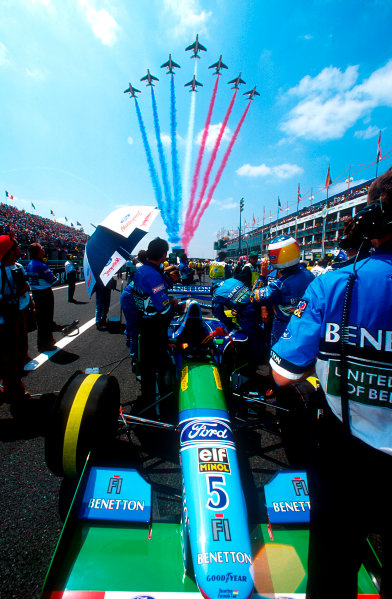 1994 French Grand Prix.Magny-Cours, France.30/6-2/7 1994.Michael Schumacher (Benetton B194 Ford) on the grid before the start, as the french Tricolor fly overhead.Ref-94 FRA 12.World Copyright - LAT Photographic