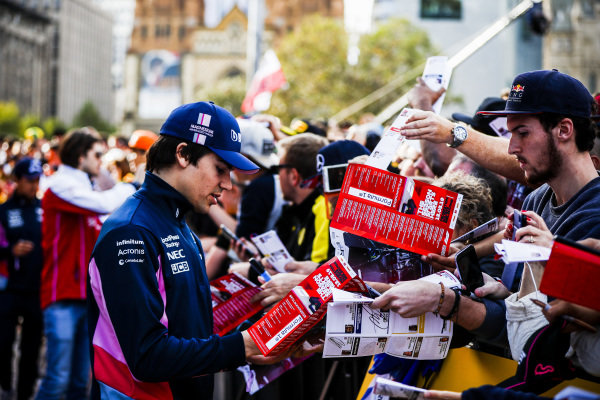 Lance Stroll, Racing Point signs an autograph for a fan at the Federation Square event