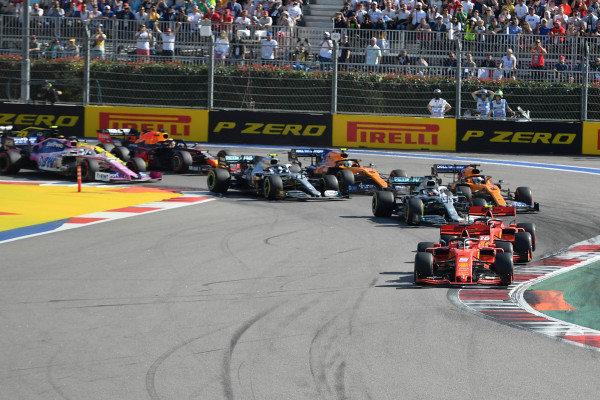 Sebastian Vettel, Ferrari SF90, leads Charles Leclerc, Ferrari SF90, Lewis Hamilton, Mercedes AMG F1 W10, Carlos Sainz Jr., McLaren MCL34, Valtteri Bottas, Mercedes AMG W10, and the rest of the field at the start