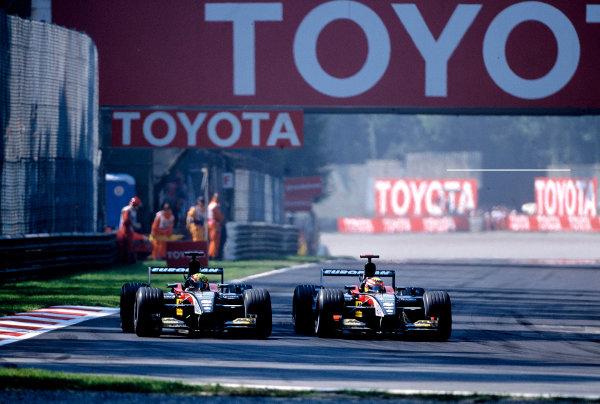 2002 Italian Grand PrixMonza, Italy. 14th - 16th September 2002Mark Webber, KL Minardi Asiatech PS02, makes way for team mate Alex Yoong, KL Minardi Asiatech PS02.World Copyright - LAT Photographicref: 35mm Transparency 02_ITA_19