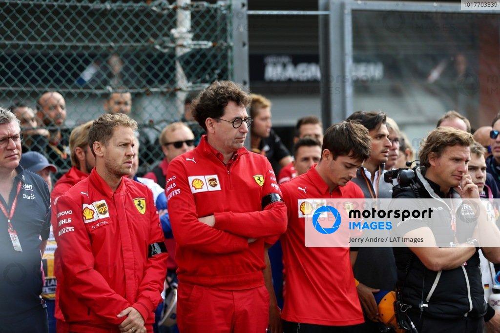 Sebastian Vettel, Ferrari, Mattia Binotto, Team Principal Ferrari, and Charles Leclerc, Ferrari, stand on the grid for the memorial of Anthoine Hubert (FRA, BWT ARDEN)