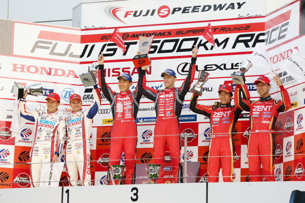GT500 winners Tsugio Matsuda & Ronnie Quintarelli, who shared the number 23 Motel Autech NISMO Nissan GT-R, celebrate on the podium. The second position duo of Heikki Kovalainen & Sho Tsuboi, Denso Kobelco SARD Lexus LC500 also raise their trophies, along with third placed drivers Yuji Tachikawa & Hiroaki Ishiura, Zent Cerumo Lexus LC500.