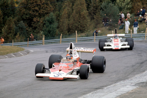 1974 Canadian Grand Prix.Mosport Park, Canada. 22 September 1974.Emerson Fittipaldi (McLaren M23-Ford) leads Graham Hill.World Copyright: LAT Photographicref: 35mm Transparency Image