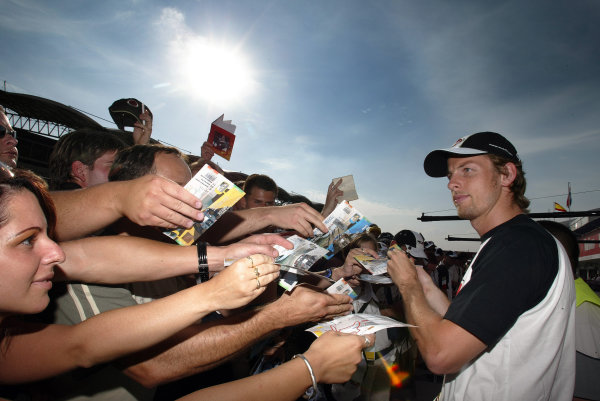 2004 Hungarian Grand Prix - Thursday,2004 Hungarian Grand Prix Budapest, Hungary. 12th August 2004 Jenson Button, BAR Honda 006 signs autographs for his fans.World Copyright: Steve Etherington/LAT Photographic ref: Digital Image Only