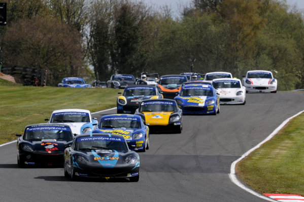 2014 Protyre Motorsport Ginetta GT5 Challenge, Oulton Park, Cheshire. 19th April 2014. Start of Race 1 Gary Simms (GBR) Buddy Racing Ginetta G40 leads. World Copyright: Ebrey / LAT Photographic.