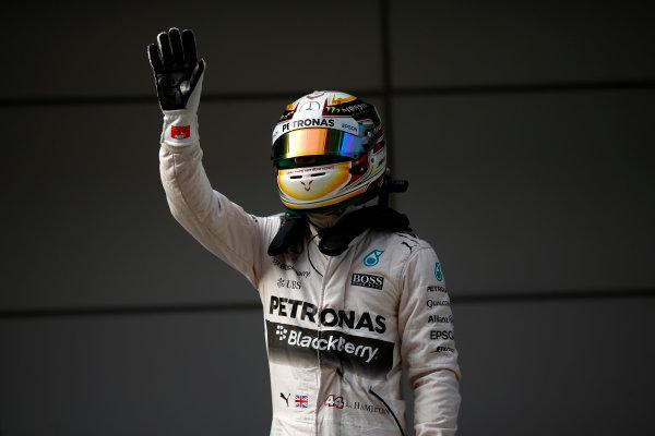 Shanghai International Circuit, Shanghai, China. Saturday 11 April 2015. Pe man Lewis Hamilton, Mercedes AMG. World Copyright: Andrew Hone/LAT Photographic. ref: Digital Image _ONZ1638