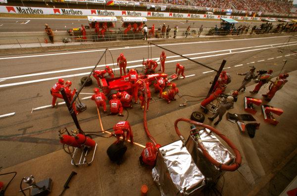 Barcelona, Spain.23-25 May 1997.Eddie Irvine (Ferrari F310B) 12th position, takes a pitstop.Ref-97 ESP 06.World  Copyright - LAT Photographic