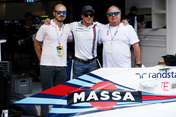 Interlagos, Sao Paulo, Brazil. Thursday 10 November 2016. Felipe Massa, Williams Martini Racing, unveils a new livery for his final home grand prix, and poses with his brother and father. World Copyright: Glenn Dunbar/LAT Photographic ref: Digital Image _X4I1897