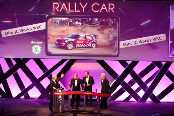 Grosvenor House Hotel, Park Lane, London 4th December 2011 David Richards and Dr Kay Segler accept the Rally Car of the Year award on behalf of the Mini John Cooper Works WRC from Carlos Sainz on the stage.World Copyright: Glenn Dunbar/LAT Photographic ref: Digtal Image GD5D0287