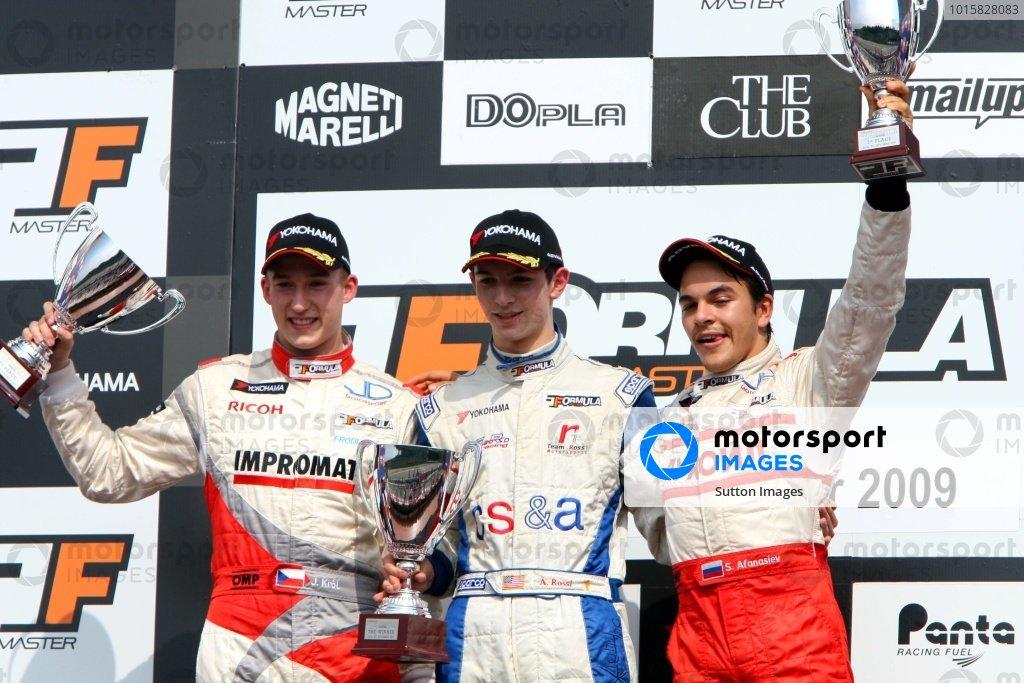 Race 2 podium and results: 1st Alexander Rossi (USA) ISR, centre. 2nd Josef Kral (CZE), JD Motorsport, left. 3rd Sergey Afanasiev (RUS), JD Motorsport, right. International Formula Master, Rd8, Imola, San Marino, Italy, 20 September 2009.