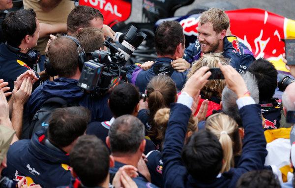 Interlagos, Sao Paulo, Brazil. Sunday 24th November 2013.  Sebastian Vettel, Red Bull Racing, 1st position, celebrates with his team in Parc Ferme. World Copyright: Steven Tee/LAT Photographic. ref: Digital Image _14P1466