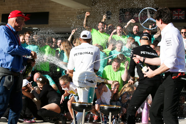 Circuit of the Americas, Austin, Texas, United States of America. Sunday 22 October 2017. Lewis Hamilton, Mercedes AMG, 1st Position, Niki Lauda, Non-Executive Chairman, Mercedes AMG, Valtteri Bottas, Mercedes AMG, Toto Wolff, Executive Director (Business), Mercedes AMG, Nick Hamilton and the Mercedes team celebrate winning the race and the Constructors title. World Copyright: Charles Coates/LAT Images  ref: Digital Image AN7T2398