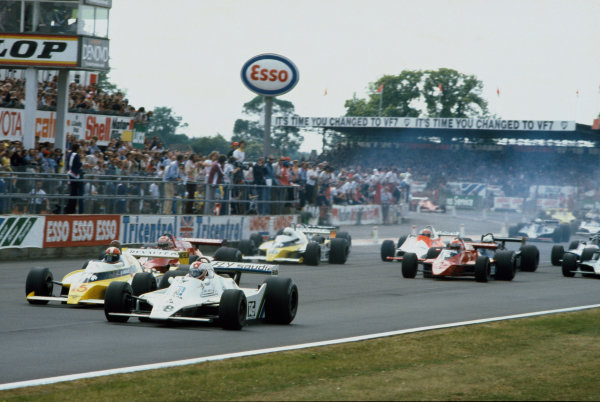 Silverstone, England. 12-14 July 1979. Clay Regazzoni (Williams FW07-Ford), 1st position, leads away at the start of the race.This was Williams Grand Prix Engineering's maiden Grand Prix victory, action.  World Copyright: LAT Photographic. Ref:  79GB12.