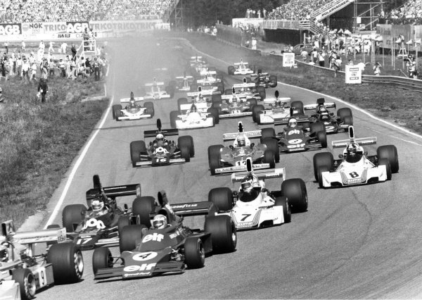 1975 Swedish Grand Prix. Anderstorp, Sweden. 6-8 June 1975. Vittorio Brambilla, March 751-Ford, retired, leads the field through the first corner followed by Patrick Depailler, Tyrrell 007-Ford, 12th position, Jean-Pierre Jarier, Shadow DN5A-Ford, retired, Carlos Reutemann, Brabham BT44B-Ford, 2nd position, Carlos Pace, Brabham BT44B-Ford, retired and eventual winner Niki Lauda, Ferrari 312T, 1st position, action.World Copyright - LAT Photographic.Ref: B/W print.