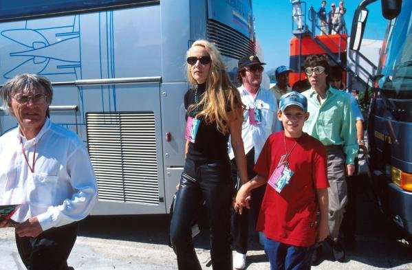 Rock Star Mick Jagger and his wife Jerry Hall are escorted around the F1 paddock by Bernie Ecclestone(GBR) F1 Supremo Portugese Grand Prix, Estoril, 24 September 1995