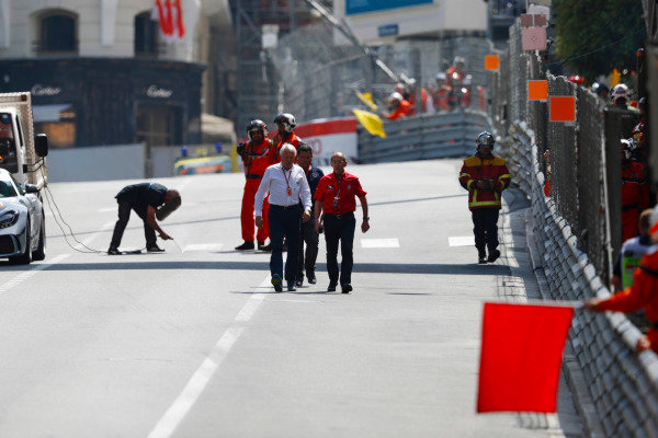 Charlie Whiting, Race Director, FIA, conducts a circuit inspection during a red flag period in FP2.