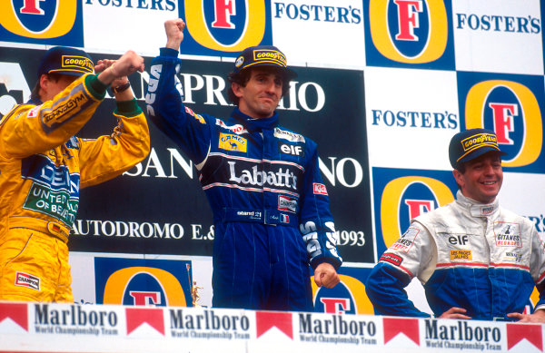 Imola, Italy.23-25 April 1993.Alain Prost (Williams Renault) 1st position, Michael Schumacher (Benetton Ford) 2nd position and Martin Brundle (Ligier Renault) 3rd position on the podium.Ref-93 SM 04.World Copyright - LAT Photographic