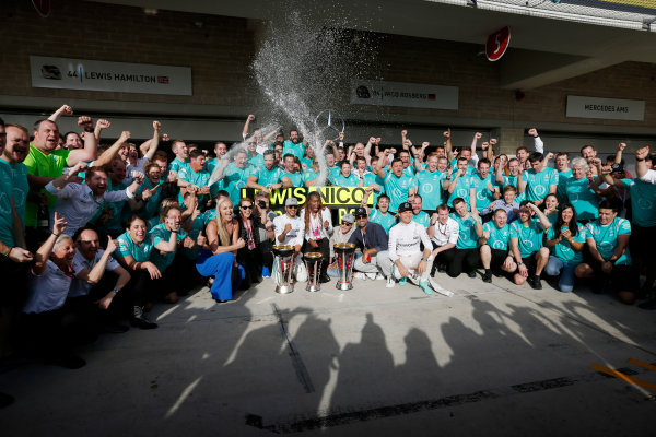 Circuit of the Americas, Austin Texas, USA. Sunday 23 October 2016. Lewis Hamilton, Mercedes AMG, 1st Position, and Nico Rosberg, Mercedes AMG, 2nd Position, celebrate with Skier Lindsey Vonn, Actress Noomi Rapace, Tennis star Venus Williams and the Mercedes AMG team. World Copyright: Sam Bloxham/LAT Photographic ref: Digital Image _SBB2139