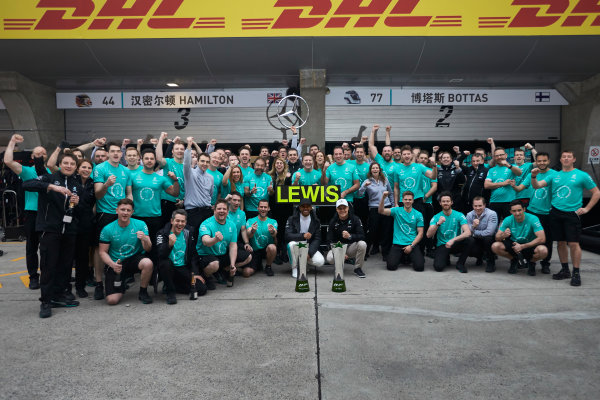 Shanghai International Circuit, Shanghai, China.  Sunday 9 April 2017. Lewis Hamilton, Mercedes AMG, 1st Position, Valtteri Bottas, Mercedes AMG, and the Mercedes team celebrate victory. World Copyright: Steve Etherington/LAT Images ref: Digital Image SNE19080