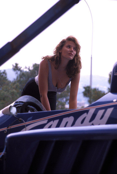 A model poses with a Ligier JS25 Renault in the pits.