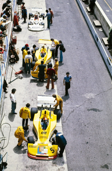 Jean-Pierre Jabouille, Elf 2J Renault/Gordini, Michel Leclère, Elf 2J Renault/Gordini, and Giancarlo Martini, March 762 BMW/Minardi, in the pitlane.