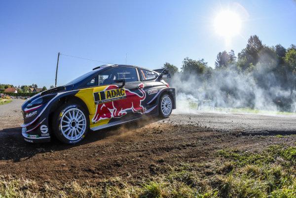Sliding wide on a left-hand hairpin, Sebastien Ogier in his Ford Fiesta WRC