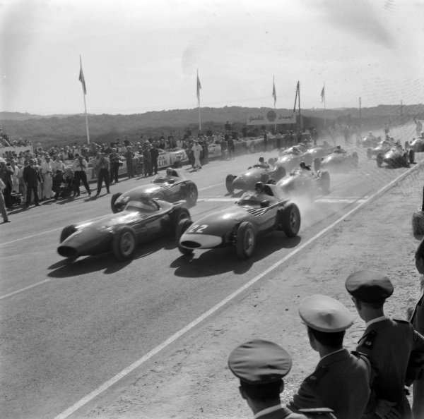 Jean Behra, Maserati 250F, leads at the start from Tony Brooks, Vanwall, and Stuart Lewis-Evans, Vanwall.