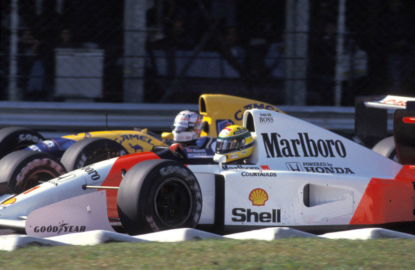 Ayrton Senna, McLaren MP4-7A Honda, battles with Nigel Mansell, Williams FW14B Renault.