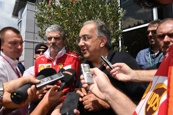 Maurizio Arrivabene (ITA) Ferrari Team Principal and Sergio Marchionne (ITA) CEO FIAT talk with the media at Formula One World Championship, Rd9, Austrian Grand Prix, Race, Spielberg, Austria, Sunday 9 July 2017.