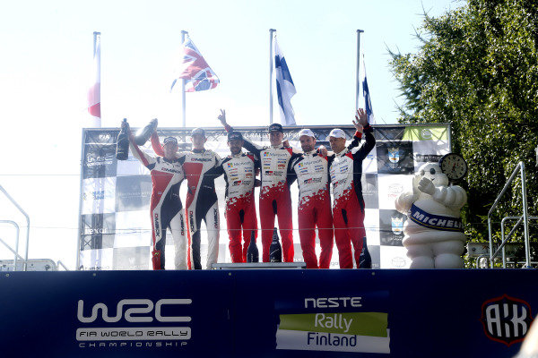 Podium (L to R): Second placed Elfyn Evans (GBR) / Daniel Barritt (GBR), M-Sport World Rally Team WRC, rally winners Esapekka Lappi (FIN) / Janne Ferm (FIN), Toyota Gazoo Racing WRT WRC and third placed Juho Hanninen (FIN) / Kaj Lindstrom (FIN), Toyota Gazoo Racing WRC celebrate on the podium with the champagne at World Rally Championship, Rd9, Rally Finland, Day Three, Jyvaskyla, Finland, 30 July 2017.