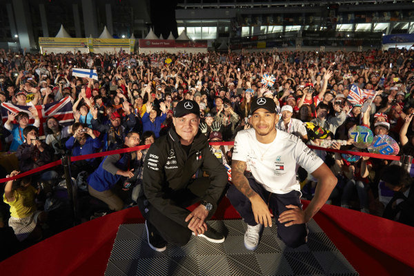 Valtteri Bottas, Mercedes AMG F1, and Lewis Hamilton, Mercedes AMG F1, with a huge crowd behind