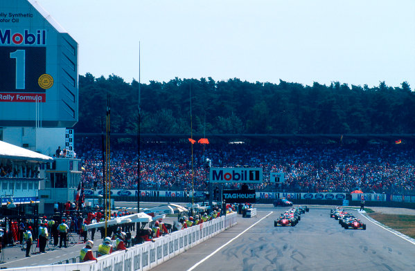 1994 German Grand Prix.Hockenheim, Germany.29-31 July 1994.Gerhard Berger on pole with teammate Jean Alesi (both Ferrari 412T1B's) on the front row of the grid with him for the start.Ref-94 GER 18.World Copyright - LAT Photographic