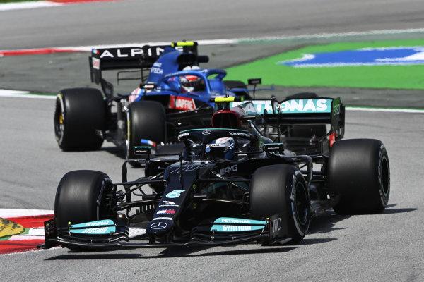 Valtteri Bottas, Mercedes W12, leads Esteban Ocon, Alpine A521