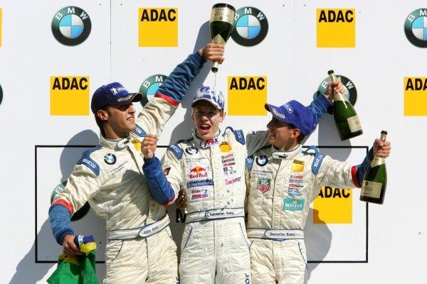 Podium, Sebastian Vettel (GER), ADAC Berlin Brandenburg e.V. (1st, center), Atila de Abreu (BRA), ADAC Mittelrhein e.V. (2nd, left) and Sebastien Buemi (SUI), Lars Kaufmann Motorsport (3rd. right). Formula BMW ADAC Championship 2004, Rd 17&18, Brno, Czech Republic. 18 September 2004. DIGITAL IMAGE