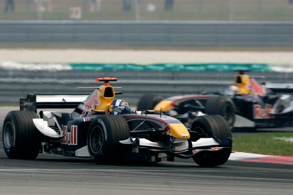 2005 Malaysian Grand Prix - Sunday Race, Sepang, Kuala Lumpur, Malaysia. 20th March 2005David Coulthard, Red Bull Racing Cosworth RB1 leads team-mate Christian Klien.World Copyright: LAT Photographic ref: Digital Image Only