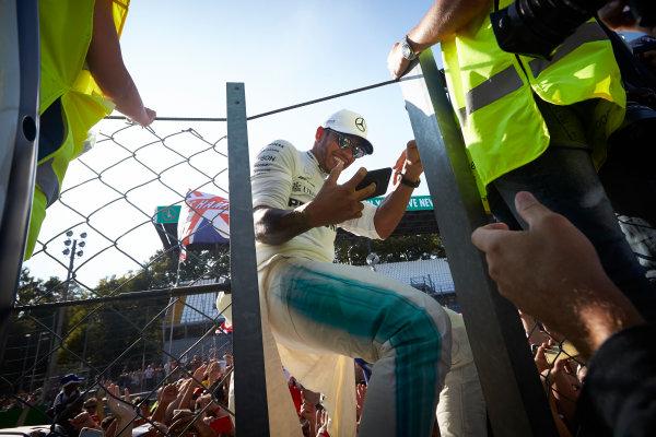 Autodromo Nazionale di Monza, Italy. Sunday 3 September 2017. Lewis Hamilton, Mercedes AMG, takes a photo with fans. World Copyright: Steve Etherington/LAT Images  ref: Digital Image SNE15625