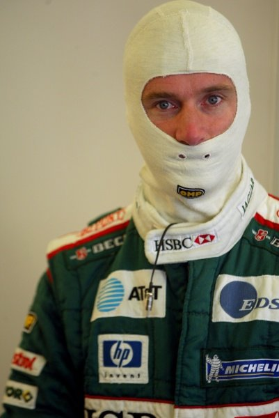 Eddie Irvine (GBR) Jaguar in the garage.