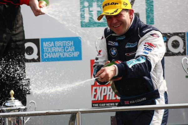 Brands Hatch, UK. 5th April 2009. Rds 1,2,3. Rob Collard, Motorbase BMW, celebrates the team's first BTCC win, on the podium. Portrait.  World Copyright: Kevin Wood/LAT Photographic Ref: Digital Image IMG_9073a