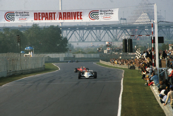 Montreal, Quebec, Canada. 28 - 30 September 1979.Alan Jones (Williams FW07-Ford), 1st position, leads Gilles Villeneuve (Ferrari 312T4) 2nd position, action. World Copyright: LAT Photographic.Ref:  79CAN02.