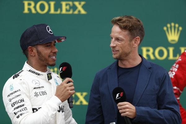 Silverstone, Northamptonshire, UK.  Sunday 16 July 2017. Lewis Hamilton, Mercedes AMG, 1st Position, is interviewed by Jenson Button, McLaren, on the podium. World Copyright: Glenn Dunbar/LAT Images  ref: Digital Image _X4I8344