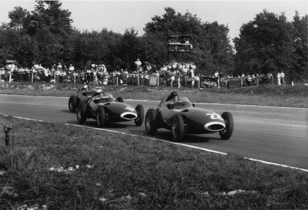 Monza, Italy. 6th - 8th September 1957.Stirling Moss (Vanwall), 1st position, chases Tony Brooks (Vanwall), 7th position and is followed by Stuart Lewis-Evans (Vanwall), retired, action.World Copyright: LAT PhotographicRef: 490 - 24.