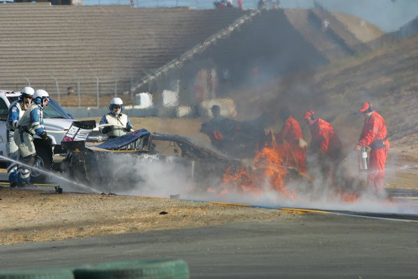 2004 American Le Mans Series (ALMS)Infineon Grand Prix of Sonoma, Sears Point. 16th - 18th July.IMSA and ALMS safety crew out fire of Earnhardt's car following crash.World Copyright: Richard Dole/LAT Photographicref: Digital Image Only