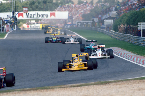 Estoril, Portugal. 21st - 23rd September 1990.Martin Donnelly (Lotus 102-Lamborghini), retired, action. World Copyright: LAT Photographic.Ref:  90 POR 15.