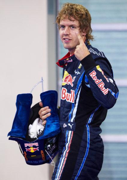 Yas Marina Circuit, Abu Dhabi, United Arab Emirates 13th November 2010. Sebastian Vettel, Red Bull Racing RB6 Renault, celebrates pole. Portrait.  World Copyright: Steve Etherington/LAT Photographic  ref: Digital Image SNE27451