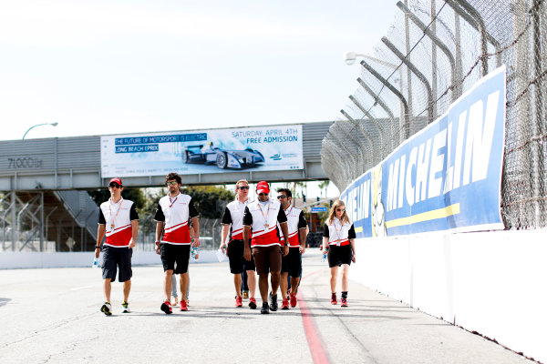 2014/2015 FIA Formula E Championship. Long Beach ePrix, Long Beach, California, United States of America. Friday 3 April 2015 Karun Chandhok (IND)/Mahindra Racing - Spark-Renault SRT_01E and Bruno Senna (BRA)/Mahindra Racing - Renault Spark ST_01 walk the track. Photo: Zak Mauger/LAT/Formula E ref: Digital Image _L0U5957