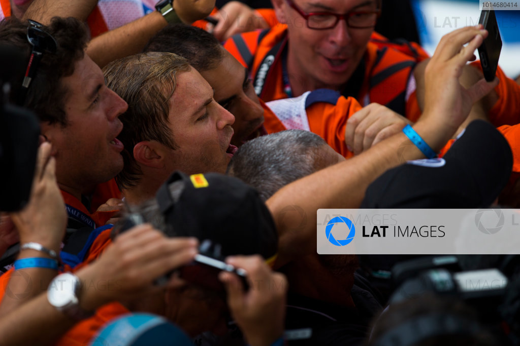 Autodromo Nazionale di Monza, Italy. Sunday 4 September 2016. Nico Rosberg, Mercedes AMG, 1st Position, celebrates and take a picture with the marshals. World Copyright: Sam Bloxham/LAT Photographic ref: Digital Image _SLA8851